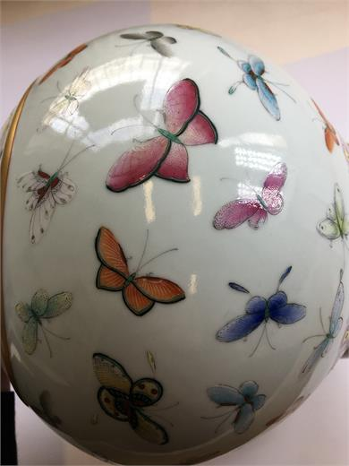 A Chinese famille rose bottle vase, the body and neck abundantly decorated with butterflies